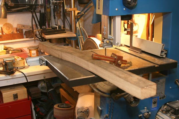 carpenters adze. then cut the first side on band saw again reading grain and correcting curves a wee bit as i read it. carpenters adze